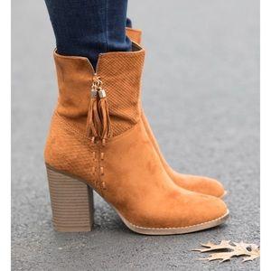 Women's cognac tassel booties size 8